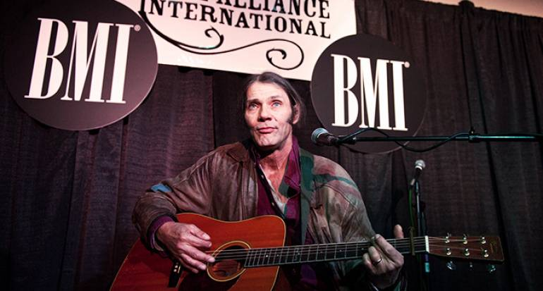 PHOTO: Malcolm Holcombe delivers an awe-inspiring performance at the BMI showcase during the 2012 Folk Alliance Conference. Photo by Erika Goldring