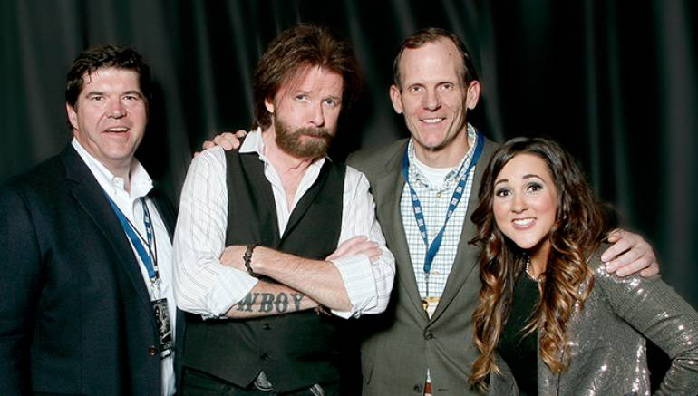 Pictured after the sold out show (left to right):  Commonwealth Broadcasting President/CEO and BMI Board Member Steve Newberry, Ronnie Dunn, BMI's Dan Spears and Brinn Black.