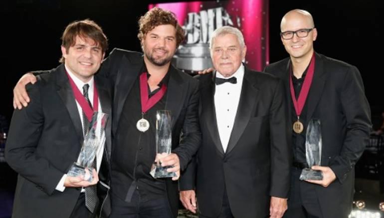Song of the Year award winner, Rhett Akins, Songwriter of the Year award winner, Dallas Davidson, BMI Icon Tom T. Hall, and Songwriter of the Year award winner Luke Laird at BMI Country Awards.