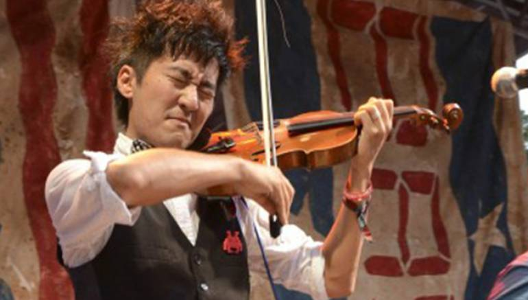 Pictured:  Kishi Bashi is kicking it on the BMI Stage at the Austin City Limits Festival.