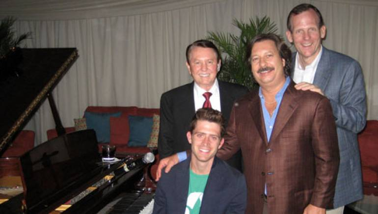 Pictured with James (seated) after his performance are (l-r): Beasley Broadcast Group, Inc. Chairman George Beasley, BBGI President Bruce Beasley and BMI's Dan Spears