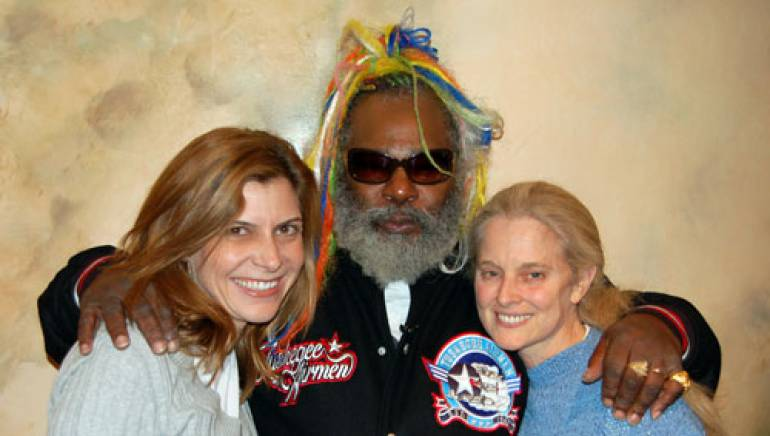 Shown grooving out are BMI's Tracie Verlinde (r), Clinton, and BMI's Barbara Cane (l).