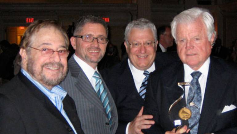 "Pictured (top) at the ""Grammys on the Hill"" dinner gala are legendary producer Phil Ramone, who presented the award; BMI Executive Vice President & Chief Operating Officer John Cody; BMI Senior Vice President, Government Relations, Fred Cannon, who also serves as the president of the Washington, D.C. chapter of the Recording Academy; and honoree Senator Ted Kennedy."