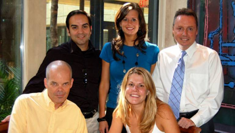 Pictured at BMI are (l to r): Elevation Music Publishing's Mike Molinar, BMI's Beth Mason and Jody Williams, with George Teren and Elevation Music Publishing's Martha Irwin, seated.