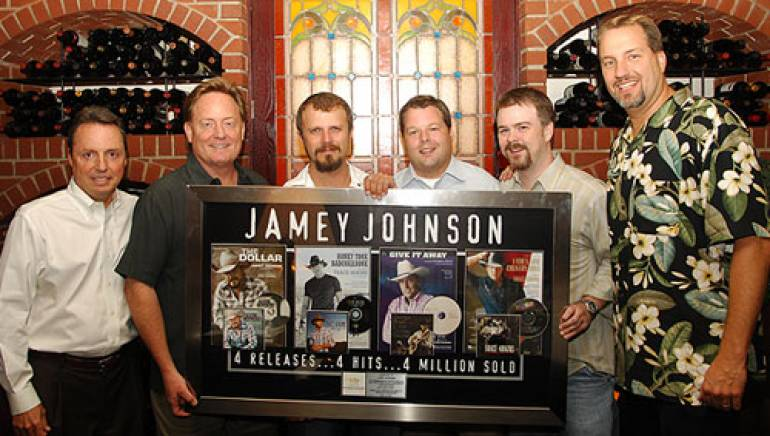 Pictured at the party are (l to r): BMI's Jody Williams, EMI's Gary Overton, Jamey Johnson and BMI's Bradley Collins, with EMI's Ben Vaughn and Tom Luteran.