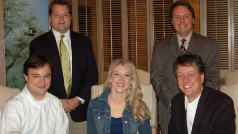 BMI's Bradley Collins and Jody Williams (standing) welcome attorney Joel Tisinger, BMI songwriter Misty Loggins and Big Tractor Music's Jason Krupek (seated) to BMI's Nashville office.