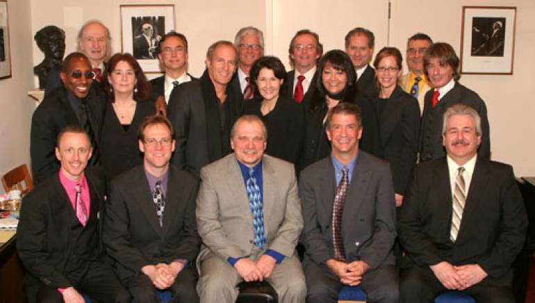 Shown at the presentation are (l-r, bottom row): award recipient teachers Brad Schoener, Matthew Eaton, Stanley Bawol, Matthew McKagan, and Steven Spinosa;  (second row) MHOF board member and keyboard player with Toto Greg Phillinganes; MHOF board member Andrea Kaiser; celebrity presenter Michael Bolton; MHOF executive director Felice Mancini; BMI's Doreen Ringer Ross, MHOF president of the board; MHOF program director Tricia Steel; and MHOF co-founder and artist manager Bobby Urband; (top row) MHOF board member Gabe Kosakoff; NY Pops conductor Rob Fisher; MHOF board member and Guitar Center CEO Marty Albertson; MHOF board member and music editor Chris Brooks; MHOF board member and conductor Charles Peltz; and MHOF board member Simeon Loring.