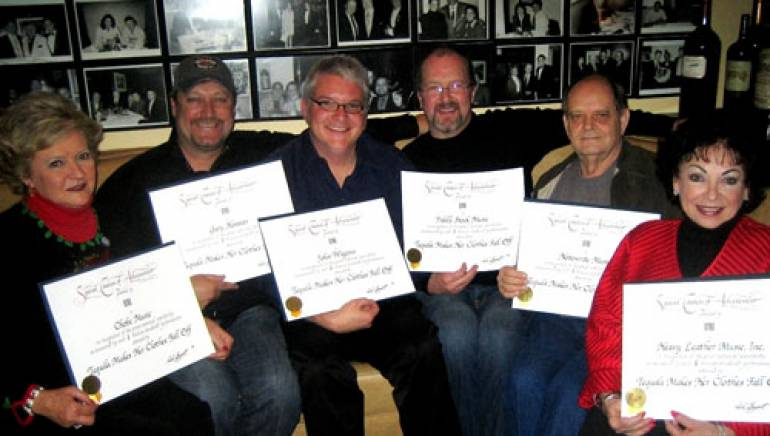 Pictured are (l to r): Chobe Music's Karen Sturgeon, songwriter Gary Hannan, BMI's Perry Howard, songwriter and Fiddle Stock Music owner John Wiggins, Notewrite Music's Charlie Andrews and Heavy Leather Music's Judy Harris.
