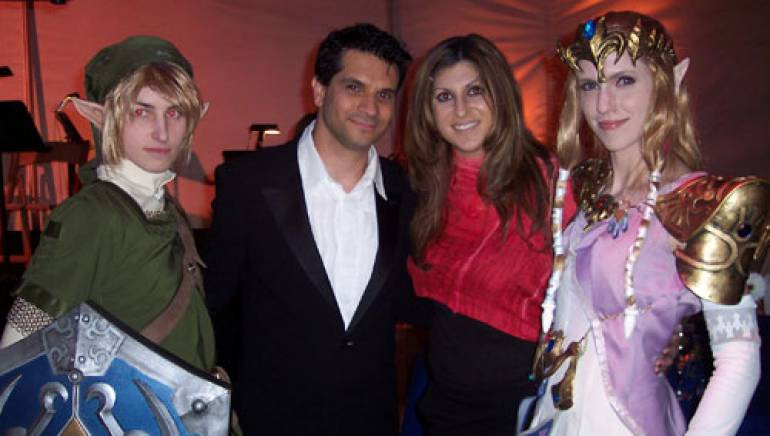 Gaming characters surround BMI composer Tommy Tallarico and BMI's Anne Cecere at the Dream Awards ceremony.