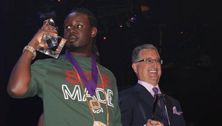 Shown are: T-Pain and BMI's President & CEO, Del Bryant