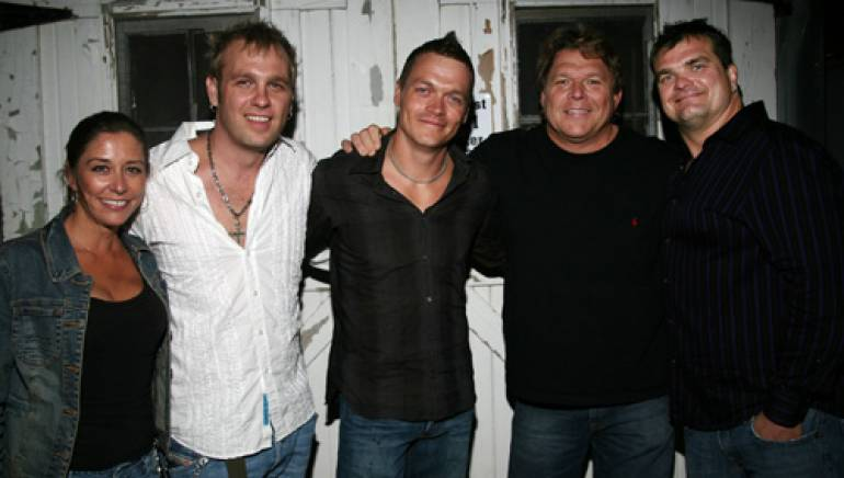 Pictured are (l to r): BMI's Mary Loving, 3 Doors Down's Todd Harrell and Brad Arnold, BMI's David Preston and 3 Doors Down's Chris Henderson.