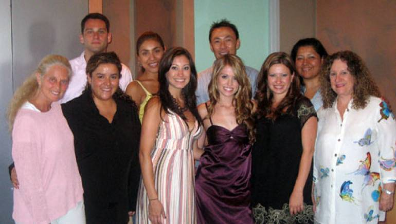 Shown are (back row, l-r): BMI's Casey Robison, Maria Elena Perez, Ray Yee and Marissa Lopez.  Front row (l-r):  BMI's Barbara Cane and Angelica Mejia, Carter's Chord sisters Emily, Joanna and Becky Robertson, and BMI's Linda Livingston.