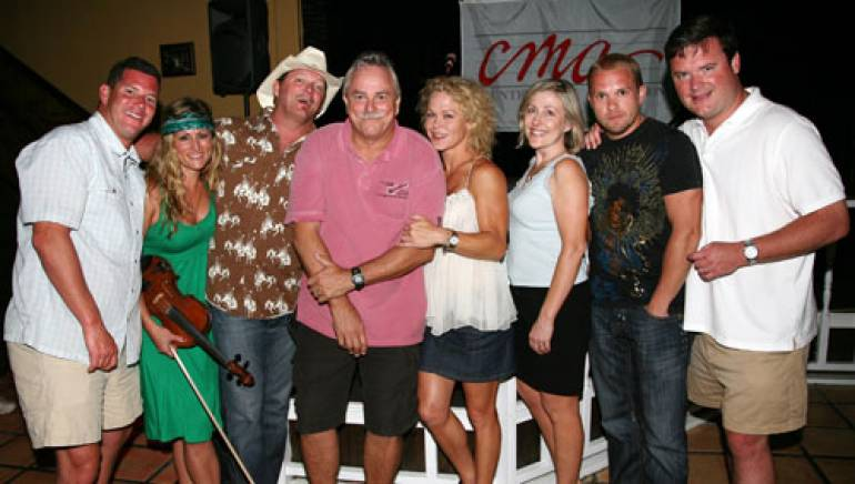 Pictured are (l to r):  BMI's Mark Mason, songwriters Nicole Witt and Joe Leathers, Hogs Breath Saloon's Charlie Bauer, the CMA's Leigh Owens and Laura Nairon, songwriter Kyle Jacobs and the CMA's Hank Adam Locklin.