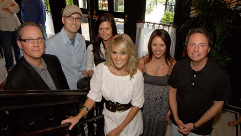 Pictured are (l-r): Carrie Underwood, front and center, with BMI's Shelby Kennedy, co-writer Luke Laird, BMI's Beth Mason, co-writer Hillary Lindsey and BMI's Jody Williams.