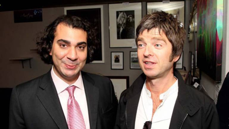 Shown at the event are (l-r): BMI Executive Director, Writer/Publisher Relations, Europe & Asia, Brandon Bakshi; and Oasis's Noel Gallagher.