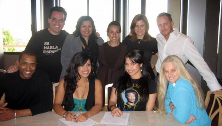 Shown at the signing (l-r, back row):  manager Jorge Hernandez, BMI's Marissa Lopez, Delia Orjuela, Tracie Verlinde and Myles Lewis. (l-r, front row):  manager Bruce Johnson, Jessica Martinez and Janelle Martinez of Prima J, and BMI's Barbara Cane.