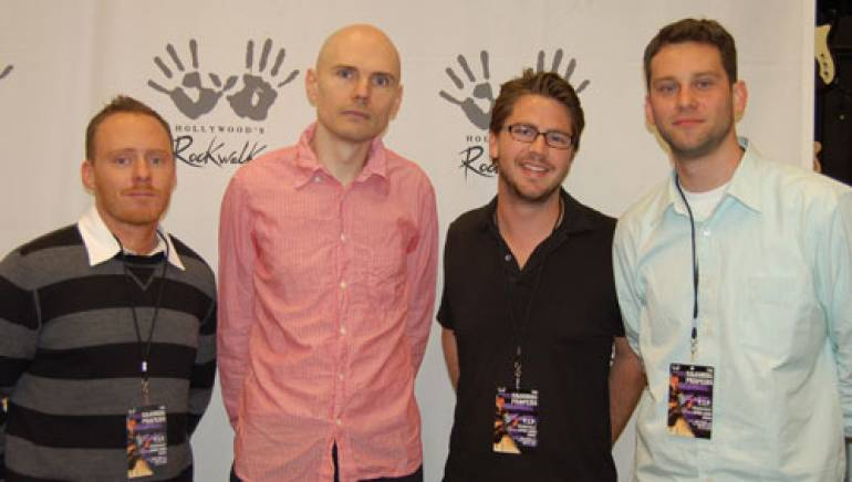 Shown at the reception are (l to r): BMI's Myles Lewis and Smashing Pumpkins' Billy Corgan, with BMI's Joe Maggini and Casey Robison.