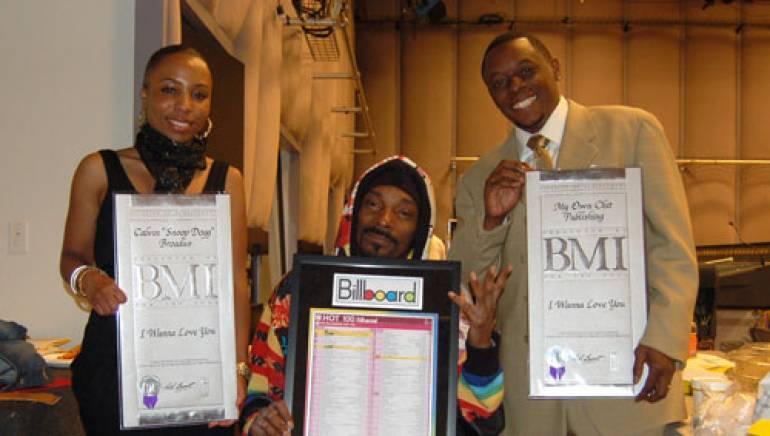 "BMI's Nicole Plantin, Calvin ""Snoop Dogg"" Broadus and BMI's Malik Levy"