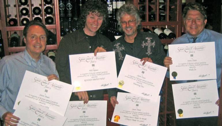 Pictured showing off Million-Air certificates are (l-r): BMI's Jody Williams, Wil Nance, Steve Dean and BMI's David Preston.