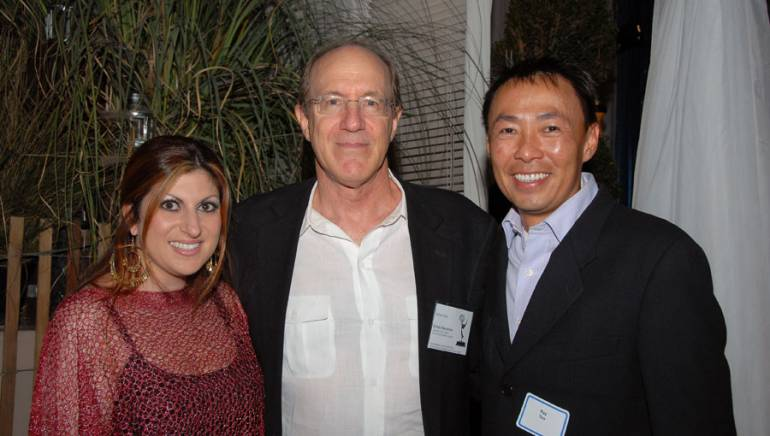 During the BMI/SCL co-hosted reception honoring 2009 Emmy music categories nominees, BMI's Anne Cecere (left) and Ray Yee (right) encourage composer William Ross, who went on to win two statuettes.