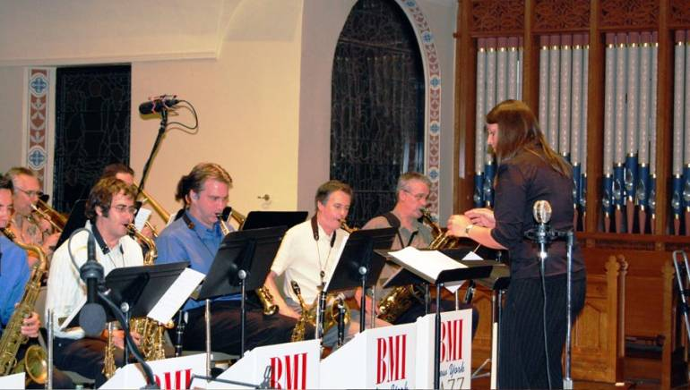 Charlie Parker Jazz Composition Prize winner Sara Jacovino conducts the BMI/New York Jazz Orchestra at the BMI Jazz Composer Workshop Showcase Concert on June 26.