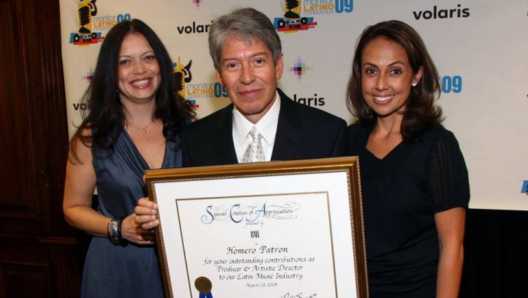 BMI honored esteemed songwriter Homero Patron during the Noche de Gala Monitor Latino Excellence Awards, held Wednesday, August 26. Pictured are BMI's Darlene Rosado, Homero Patron and BMI's Delia Orjuela. (Photo courtesy of Eddie Sakaki)