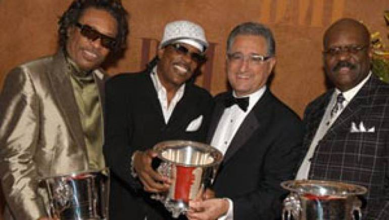 Pictured at the 2005 BMI Urban Awards are Robert Wilson and Charlie Wilson of the Gap Band; BMI President & CEO Del Bryant; and the Gap Band's Ronnie Wilson.