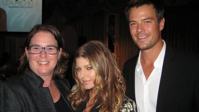 BMI's Alison Smith (l), who was honored as a Top Power Player at Billboard's Women in Music luncheon on December 2, pauses for a photo with fellow honoree Fergie and actor Josh Duhamel