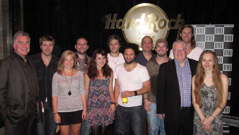 Seen in a group photo after the showcase are members of headlining band Melodime, and singer/songwriters Paul Masson, Rene Moffat and Molly Hagen, flanked by BMI Senior VPs Richard Conlon (left) and Fred Cannon (third from right).