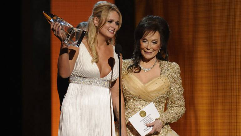 BMI legend Loretta Lynn presents Female Vocalist of the Year to Miranda Lambert during the 44th Annual CMA Awards in Nashville.