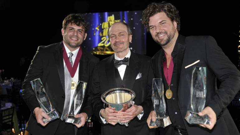 The night's big honorees gather for a photo at the 2011 BMI Country Awards in Nashville. Pictured are (l-r): Songwriter of the Year Rhett Akins, 2011 BMI Icon Bobby Braddock, and Songwriter of the Year Dallas Davidson.