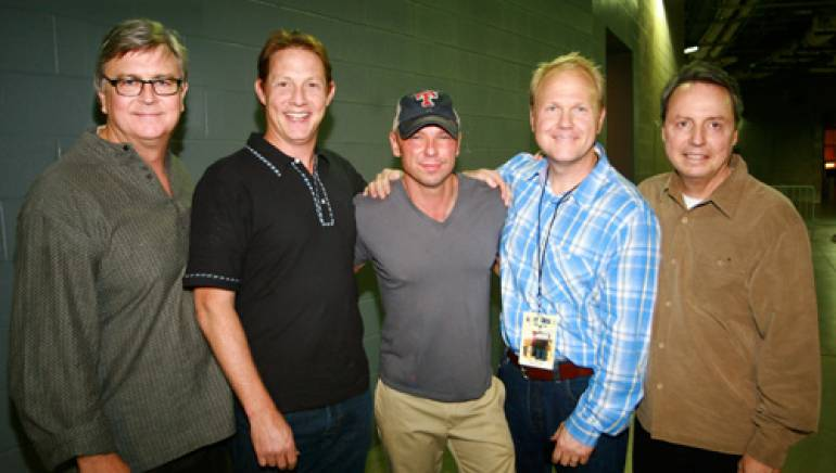 Pictured above at Texas Stadium during the Dallas stop on Chesney's 2011 Going Coastal Tour are BMI's Phil Graham and Clay Bradley, Kenny Chesney, Sony/ATV Music Publishing's Troy Tomlinson, and BMI's Jody Williams.