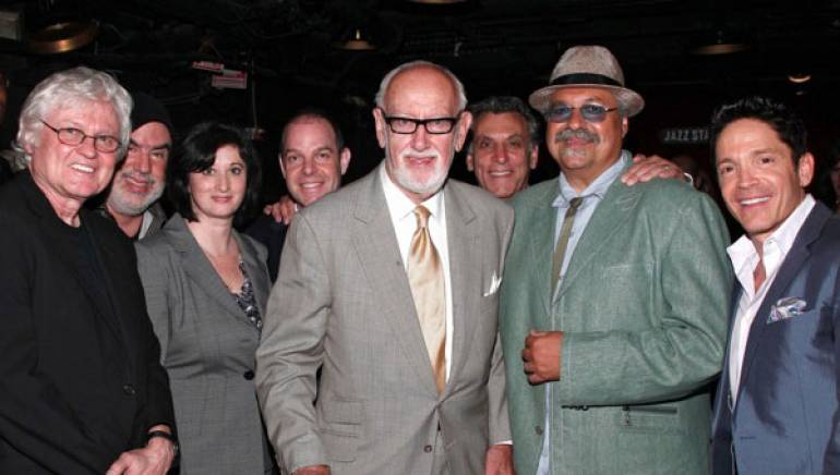 Bruce Lundvall (c) is flanked by composer/artists Chip Taylor, Randy Brecker, Renee Rosnes and Bill Charlap; Half Note Records executive Jeff Levenson; and composer/artists Joe Lovano and Dave Koz.