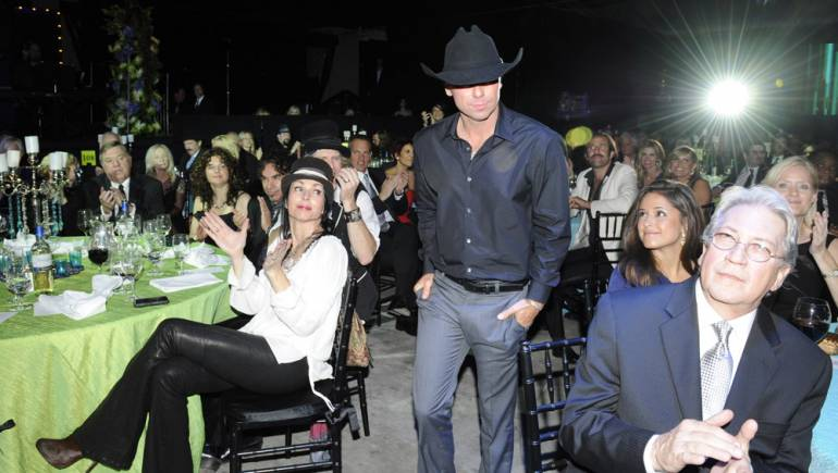 """Kenny Chesney hits the stage to receive an award for """"Somewhere with You"""" during the 2011 BMI Country Awards, held November 8 in Nashville."""