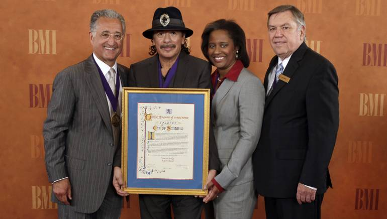 Pictured at the BMI Board's 2012 dinner during the NAB convention in Las Vegas are BMI President & CEO Del Bryant; honoree Carlos Santana; Susan Davenport Austin, Chairman of the BMI Board of Directors and Senior Vice President and Chief Financial Officer of Sheridan Broadcasting Corporation and President of the Sheridan Gospel Network; and Jack Sander, Presiding Director of the BMI board.