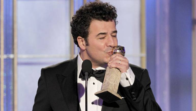 Pictured: Ludovic Bource celebrates his win for Best Original Score at the 2012 Golden Globes.