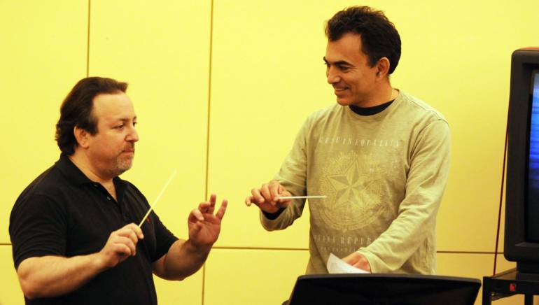 Pictured at 2011 Conducting for the Film Composer Workshop, presented by BMI: (L-R) Lucas Richman guides Daniel Hamuy thru a score.
