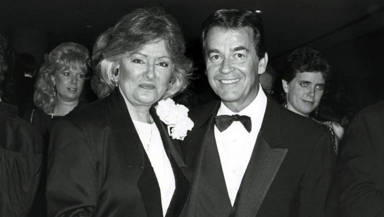 Former BMI President & CEO Frances Preston huddles for a photo with Dick Clark.