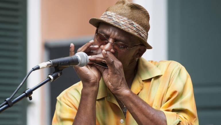 Ricky Weston performs with Colin Lake at the Historic New Orleans Collection during the French Quarter Festival.