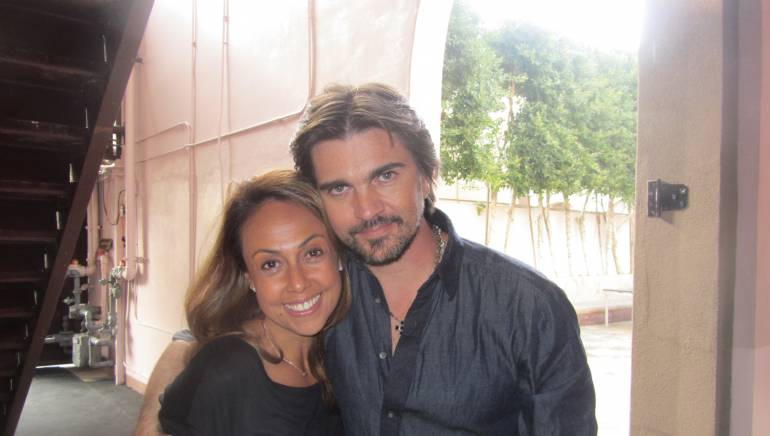 Pictured: BMI's Delia Orjuela and Juanes are all smiles at the Latin Grammy Nominations press conference.