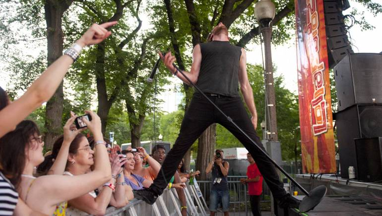 Sean Van Vleet of the band Empires strikes an unforgettable pose while performing on the BMI stage at Lollapalooza on August 5 in Chicago.