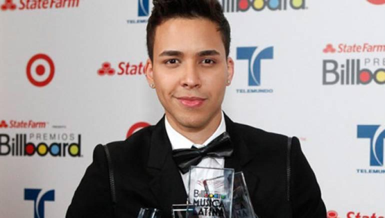 Prince Royce displays his awards haul at the 2012 Billboard Latin Music Awards in Miami.
