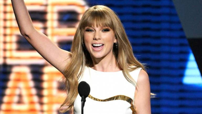 Taylor Swift celebrates her second consecutive ACM Entertainer of the Year win.