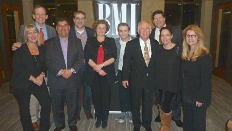 Pictured after the show L-R: Cox Media EVP Kim Guthrie, BMI's Dan Spears, CBS Radio EVP Scott Herman, Barry Dean, Hubbard Radio Chair and BMI Board member Ginny Morris, Hunter Hayes, Cromwell Group President Bud Walters, Commonwealth Broadcasting President & CEO and BMI Board member Steve Newberry, Lori McKenna, RAB President & CEO Erica Farber.