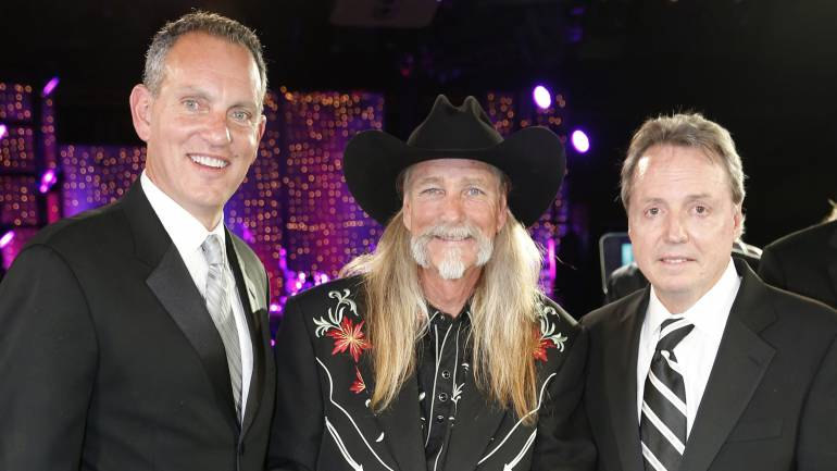 Dean Dillon is honored as a BMI Icon at the 2013 BMI Country Awards, held November 5 in Nashville. Pictured are (l-r): BMI CEO Mike O'Neill, Dean Dillon, and BMI's Jody Williams.