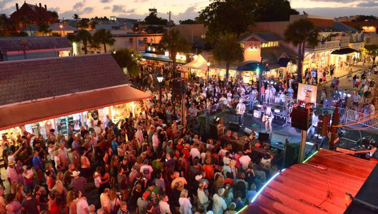 Pictured: Crowds fill Duval Street for Joanna Smith's set during the 18th Annual Key West Songwriter's Festival on Saturday, May 4, 2013.