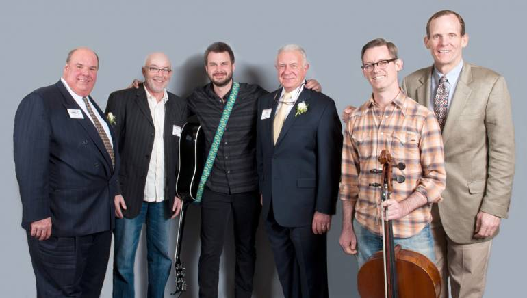 Pictured after Howie's performance (l to r): MRA Board Chair and owner of King Eider's Pub & Restaurant Todd Maurer,  Owner of Nicky's Crusin' Diner Howie Day, Sr., Howie Day,  MRA President Dick Grotton, Cellist Ward Williams and BMI's Dan Spears.