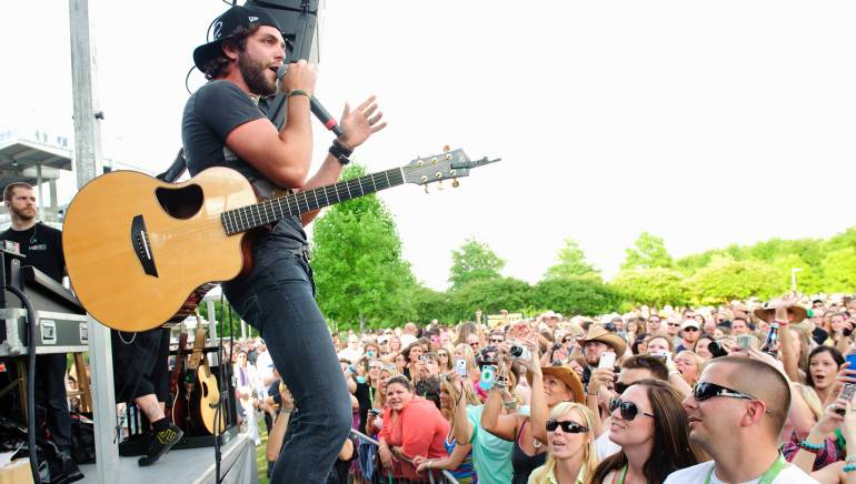 Pictured: Thomas Rhett performs at the BMI Tailgate Party outside LP Field during the 2013 CMA Music Festival on June 6, 2013, in Nashville, TN.