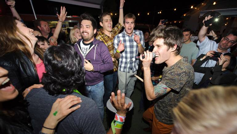 Pictured: Royal Teeth's Gary Larsen performs amidst the crowd at the BMI Indie/Rock showcase at Bar 96 during SXSW on March 14, 2013, in Austin, TX.