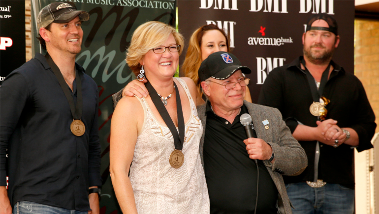 "Co-writer Connie Harrington and Paul Monti, father of US Army soldier Jared Monti, at the ""I Drive Your Truck"" No. 1 party. Also pictured (l-r): co-writers Jimmy Yeary and Jessi Alexander and artist Lee Brice."